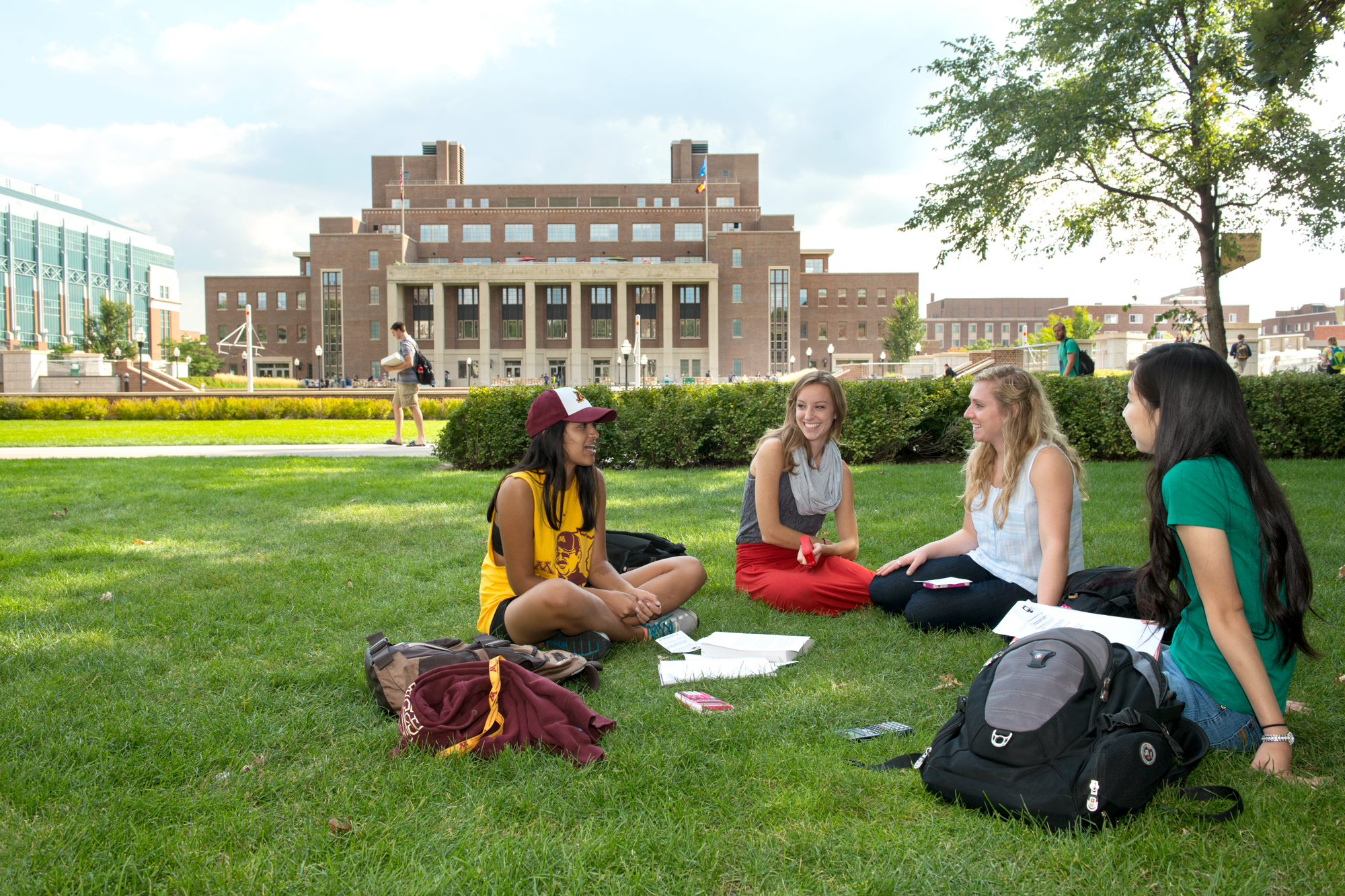 Students studying on the grass on campus